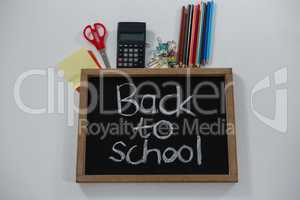 Back to school text on slate with various supplies