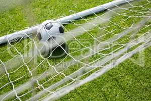 High angle view of soccer ball in goal post