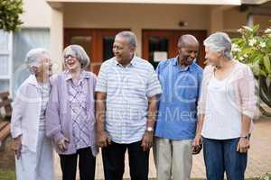 Cheerful senior men and women at nursing home