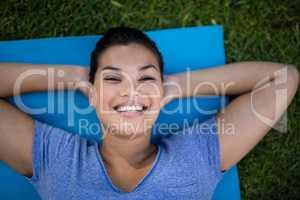 High angle portrait of smiling trainer on mat