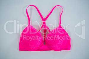 High angle view of vibrant pink bra
