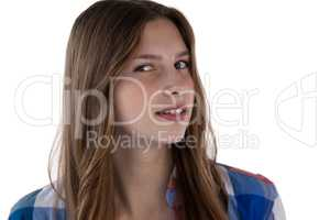 Teenager girl smiling against white background