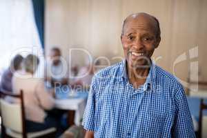 Portrait of smiling senior male at nursing home