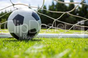 Close up of soccer ball in goal post
