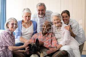 Portrait of cheerful senior people and practitioner with dog