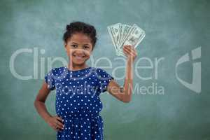 Smiling girl with hand on hip showing paper currency