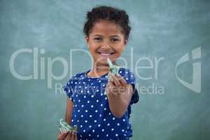 Portrait of girl giving paper currency