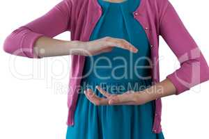 Teenage girl pretending to be hold invisible object