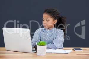 Businesswoman with curly hair using laptop computer