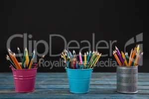 Color pencils arranged in pencil holder