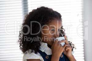Close up of businesswoman with curly hair having coffee