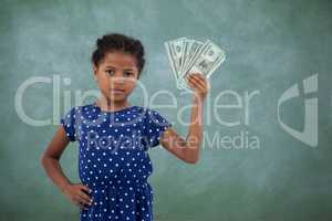 Portrait of girl with hand on hip showing paper currency