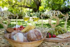 Wine glasses and food on table