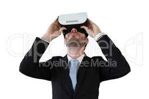 Businessman in black suit using vr glasses