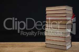 Stacked books on wooden table