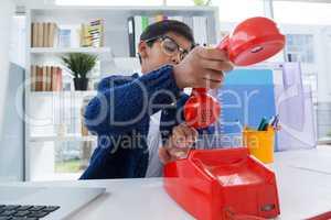 Businessman holding receiver of landline phone
