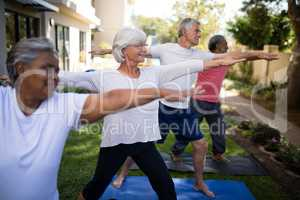 Multi-ethnic senior people stretching while exercising
