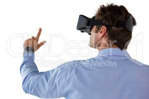 Rear view of businessman gesturing while using vr glasses