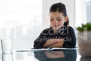 Smiling businesswoman reading document
