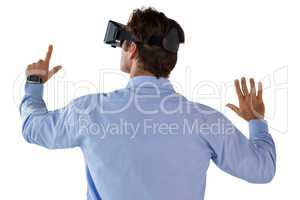 Rear view of businessman gesturing while wearing vr glass