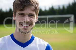 Portrait of smiling male soccer player