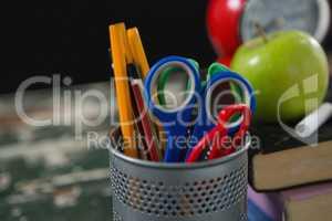 Pencils and scissors in holder