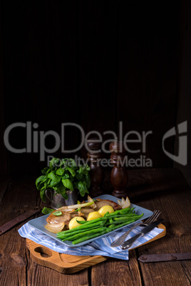 Beef medallions with caramelized beans and young potatoes