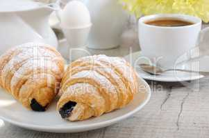 Morning coffee cup croissant