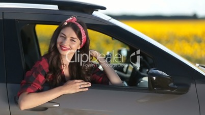 Joyful brunette woman on car summer roadtrip