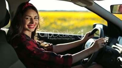 Portrait of stunning woman fastening car seatbelt
