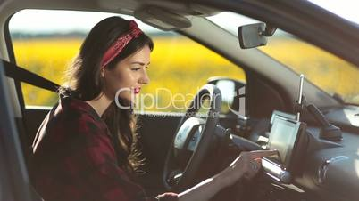 Female driver using gps navigation on trip pc