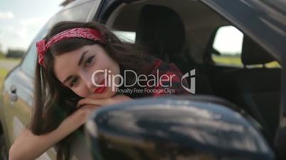 Carefree girl enjoying summer roadtrip vacation