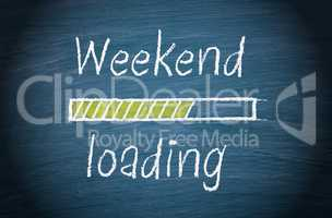 Weekend loading, blue chalkboard with text