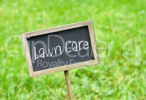 Lawn Care - chalkboard on green grass background