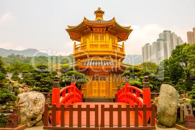 Golden Pavilion in Nan Lian Garden and Skyscrapers of Hong Kong