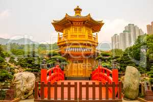 Golden Pavilion in Nan Lian Garden and Skyscrapers of Hong Kong