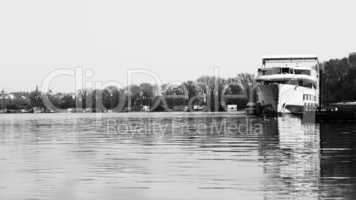 Ship Anchored at River Danube With View of the River, Boats and