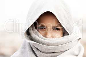 Little child boy wearing arabian burka style clothing