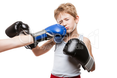 Handsome boxer child boy training boxing sport got punched