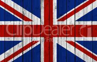 United Kingdom national flag on old wood background