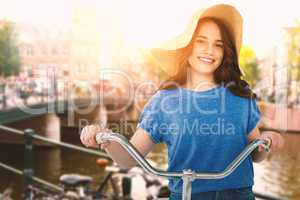 Composite image of smiling women riding bicycle