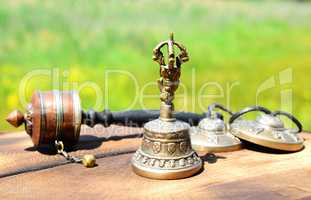 copper bell with Tibetan religious objects, close up
