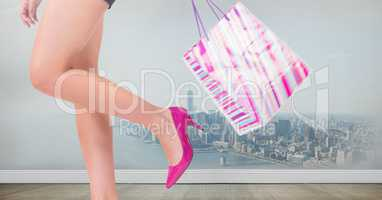 WOmens legs with shopping bag over city