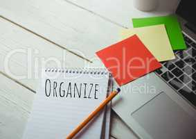 Organize  text written on page with sticky notes and laptop