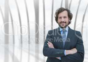 Business man standing against building background