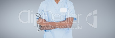 Doctor man holding a stethoscope against grey background