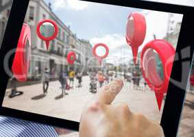Holding tablet and Location pointer markers in city street