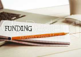 Funding text  text written on page with laptop