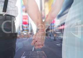 Couples hands holding together in city rush