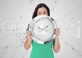 Woman holding clock in front of scientific connections